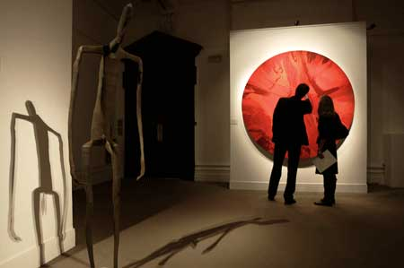 beautiful red spin painting Damien Hirst, Bono Contribute AIDS Charity With