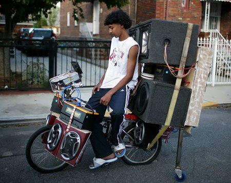Biking On Bicycle Outfitted With Amplifiers