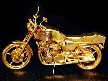 Gold Wheels: Mike Dunlap Offers Bling Automobile Sculptures