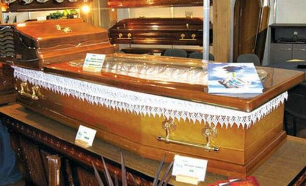 dead people in caskets pictures