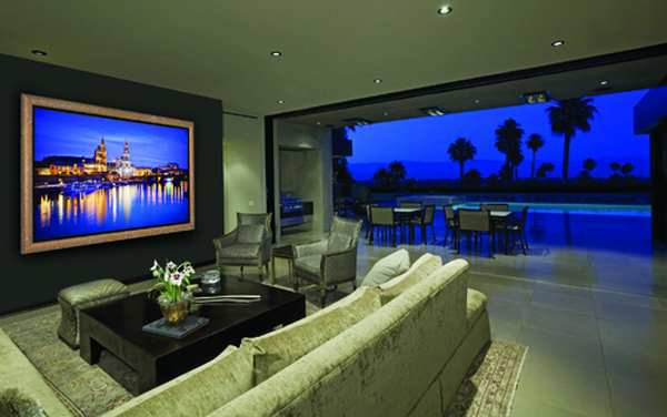 Contemporary living room with night view of pool