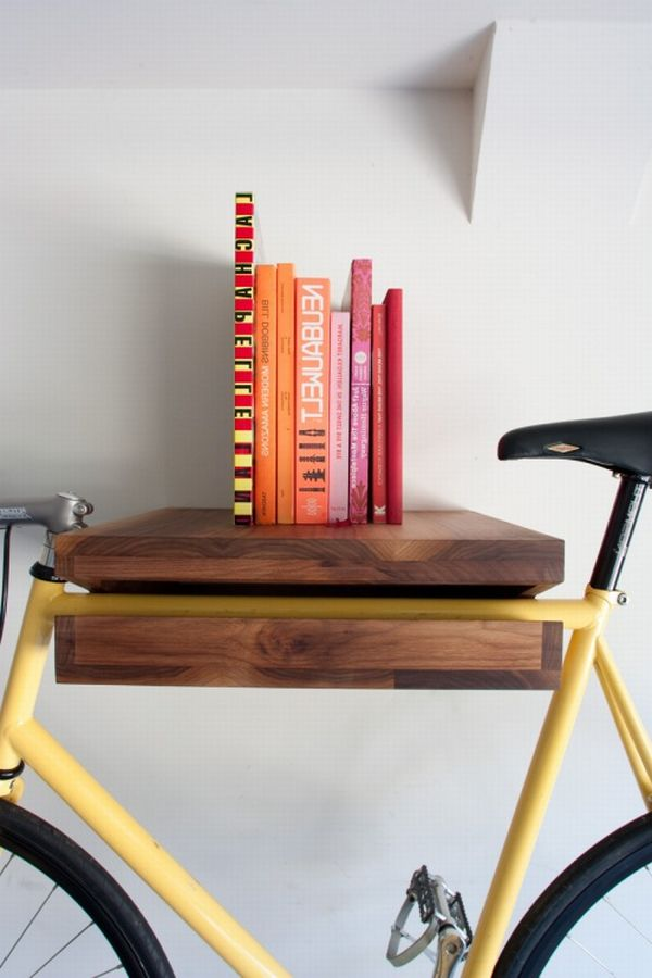 photo bikerack cu books A Bright New Idea: A Shelf That Can Hang Your Bike!