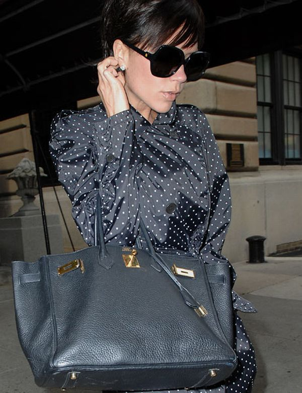 Victoria Beckham with a Hermes bag Hermès Unable to Meet Growing Demand for Scarves and Handbags