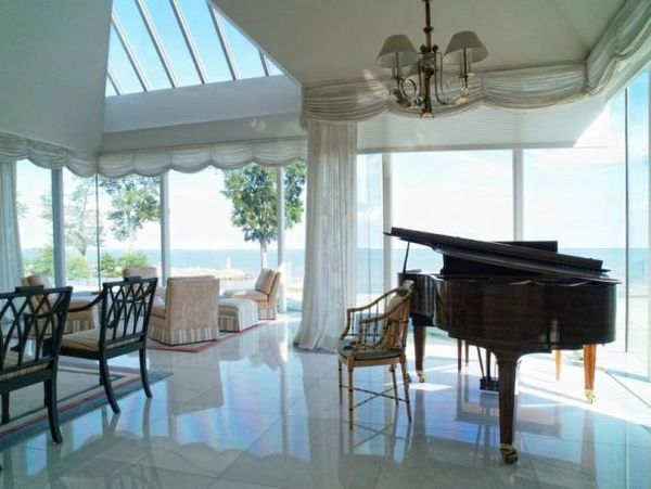 the-living-room-has-space-for-a-grand-piano-perfect-for-entertaining-guests