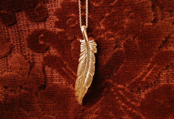 hanging magdalena feather necklace Gift Guide: Green Gifts For Her